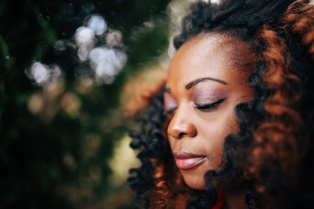 daily happiness woman meditating with eyes closed